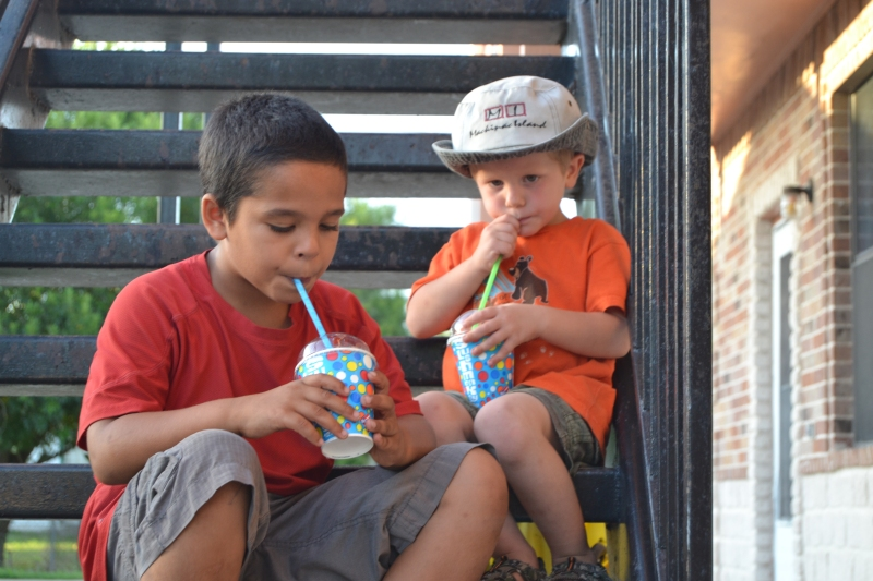 The boys enjoying a slush monkey surprise on a hot sunny day.